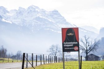 epa09056930 (FILE) - A poster of the initiative 'Yes to the burqa-ban' is seen in Oberdorf, in the canton of Nidwalden, Switzerland, 16 February 2021 (reissued 06 March 2021). Swiss citizens are called on Sunday 7 March to vote on a proposal to prohibit the concealment of one's face in the public space. Led by right-wing groups, the so-called 'anti-burqa' initiative provides for a ban on the wearing of the niqab, as well as other non-religious forms of face concealment.  EPA/URS FLUEELER