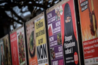 """A picture taken on March 1, 2021 in Geneva shows a serie of electoral poster with one (2nd R) in favor of a """"burqa ban"""" initiative reading in French: """"Stop Radical Islamism!"""" ahead of a nationwide vote by Swiss citizen on whether they want to ban face coverings in public on March 7, 2021, as part of the country's famous direct democratic system. (Photo by Fabrice COFFRINI / AFP) (Photo by FABRICE COFFRINI/AFP via Getty Images)"""