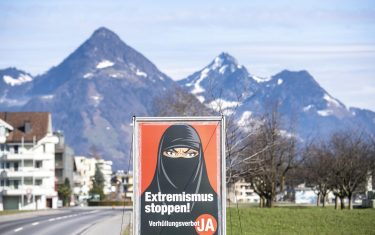 epa09056928 (FILE) - A poster of the initiative 'Yes to the burqa-ban' is seen in Oberdorf, in the canton of Nidwalden, Switzerland, 16 February 2021 (reissued 06 March 2021). Swiss citizens are called on Sunday 7 March to vote on a proposal to prohibit the concealment of one's face in the public space. Led by right-wing groups, the so-called 'anti-burqa' initiative provides for a ban on the wearing of the niqab, as well as other non-religious forms of face concealment.  EPA/URS FLUEELER
