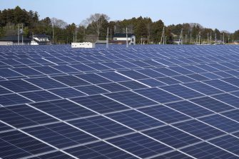 A solar farm's photovoltaic panels stands on former farmland in the Yatsuda district of Namie, Fukushima Prefecture, Japan, on Sunday, March 7, 2021. Laid waste by a nuclear disaster a decade ago, Japans Fukushima is still struggling to recover, even as the government tries to bring people and jobs back to former ghost towns by pouring in billions of dollars to decontaminate and rebuild. Photographer: Toru Hanai/Bloomberg via Getty Images