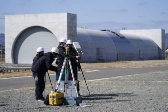 Denso Corp. employees prepare drone research near a mock-up tunnel at the Fukushima Robot Test Field in Minamisoma, Fukushima Prefecture, Japan, on Tuesday, March 9, 2021. Laid waste by a nuclear disaster a decade ago, Japans Fukushima is still struggling to recover, even as the government tries to bring people and jobs back to former ghost towns by pouring in billions of dollars to decontaminate and rebuild. Photographer: Toru Hanai/Bloomberg via Getty Images