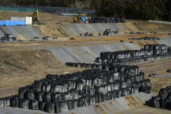 Bags of radioactive waste in Futaba, Fukushima Prefecture, Japan, on Sunday, March 7, 2021. Laid waste by a nuclear disaster a decade ago, Japans Fukushima is still struggling to recover, even as the government tries to bring people and jobs back to former ghost towns by pouring in billions of dollars to decontaminate and rebuild. Photographer: Toru Hanai/Bloomberg via Getty Images