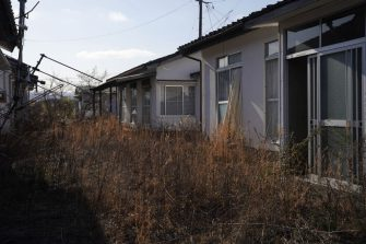 Abandoned houses at a former evacuation zone in Namie, Fukushima Prefecture, Japan, on Sunday, March 7, 2021. Laid waste by a nuclear disaster a decade ago, Japans Fukushima is still struggling to recover, even as the government tries to bring people and jobs back to former ghost towns by pouring in billions of dollars to decontaminate and rebuild. Photographer: Toru Hanai/Bloomberg via Getty Images