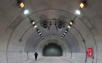 A worker walks inside a mock-up tunnel at the Fukushima Robot Test Field in Minamisoma, Fukushima Prefecture, Japan, on Tuesday, March 9, 2021. Laid waste by a nuclear disaster a decade ago, Japans Fukushima is still struggling to recover, even as the government tries to bring people and jobs back to former ghost towns by pouring in billions of dollars to decontaminate and rebuild. Photographer: Toru Hanai/Bloomberg via Getty Images