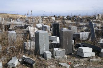 A cemetery damaged by the 2011 earthquake and tsunami is overgrown in Namie, Fukushima Prefecture, Japan, on Monday, March 8, 2021. Laid waste by a nuclear disaster a decade ago, Japans Fukushima is still struggling to recover, even as the government tries to bring people and jobs back to former ghost towns by pouring in billions of dollars to decontaminate and rebuild. Photographer: Toru Hanai/Bloomberg via Getty Images