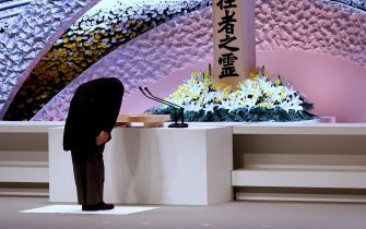 epa09066847 Japan's Prime Minister Yoshihide Suga bows in front of the altar for victims of the 11 March 2011 earthquake and tsunami after delivering his speech at the national memorial service in Tokyo, Japan, 11 March 2021. The ceremony took place on the 10th anniversary of the 9.0 magnitude earthquake which triggered a tsunami and nuclear disaster.  EPA/Behrouz MEHRI / POOL