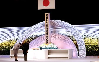 epa09066842 Japan's Emperor Naruhito (R) and Empress Masako (L) bow in front of the altar for victims of the 11 March 2011 earthquake and tsunami at the national memorial service in Tokyo, Japan, 11 March 2021. The ceremony took place on the 10th anniversary of the 9.0 magnitude earthquake which triggered a tsunami and nuclear disaster.  EPA/Behrouz MEHRI / POOL