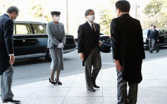 epa09066826 Japanese Emperor Naruhito (2-R) and Empress Masako (2-L) wearing face masks arrive at the National Theater of Japan to attend the national memorial service for the victims of the earthquake and tsunami that devastated northern Japan on 11 March 2011, in Tokyo, Japan, 11 March 2021. Japan on 11 March 2021 marks the 10th anniversary of the Great East Japan Earthquake that caused tsunami and a nuclear crisis.  EPA/Rodrigo Reyes Marin / POOL