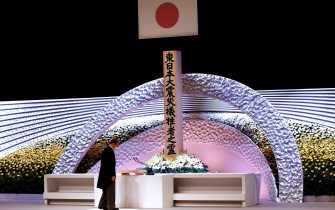 epa09066846 Japan's Prime Minister Yoshihide Suga bows in front of the altar for victims of the 11 March 2011 earthquake and tsunami after delivering his speech at the national memorial service in Tokyo, Japan, 11 March 2021. The ceremony took place on the 10th anniversary of the 9.0 magnitude earthquake which triggered a tsunami and nuclear disaster.  EPA/Behrouz MEHRI / POOL