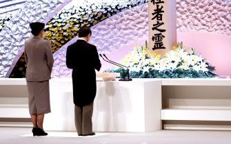 epa09066841 Japan's Emperor Naruhito (R) accompanied by Empress Masako (L) delivers his speech in front of the altar for victims of the 11 March 2011 earthquake and tsunami at the national memorial service in Tokyo, Japan, 11 March 2021. The ceremony took place on the 10th anniversary of the 9.0 magnitude earthquake which triggered a tsunami and nuclear disaster.  EPA/Behrouz MEHRI / POOL
