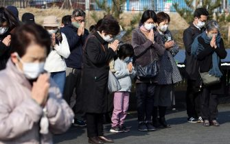 epa09066867 People observe a moment of silent prayers for the victims of the devastating 2011 earthquake and tsunami in Ishinomaki, Miyagi prefecture, northeastern Japan, 11 March 2021. Japan is commemorating the 10th anniversary of the Great East Japan Earthquake and subsequent tsunami in which approximately 20,000 people lost their lives on 11 March 2011.  EPA/JIJI PRESS JAPAN OUT EDITORIAL USE ONLY/  NO ARCHIVES