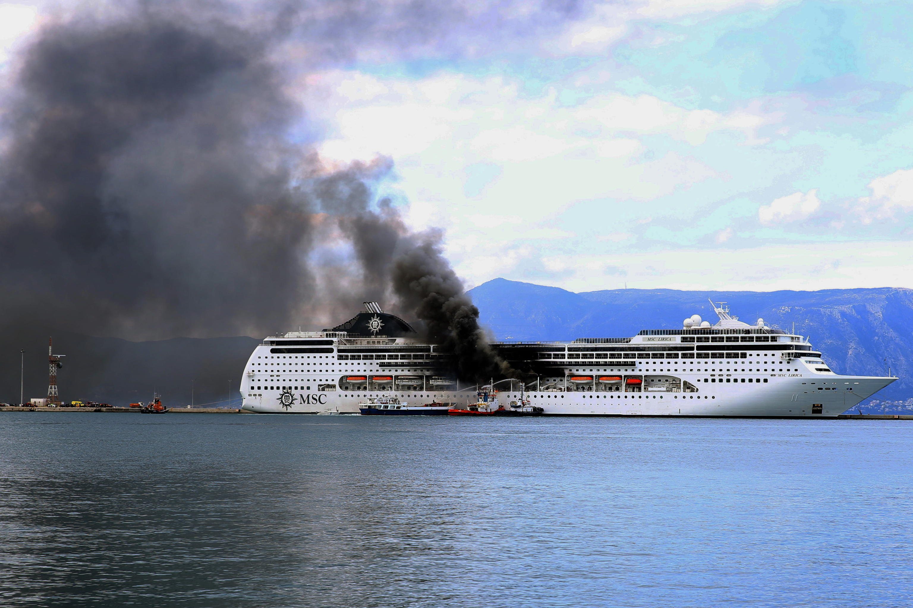 epa09069959 A fire broke out  on the 'MSC Lirica' cruiseship on 12 March 2021, while it was tied at the Corfu port, Ionian Sea, Greece, since January 30 for the winter season. Onboard were crew members only. The cause of the fire, which broke out at starboard, was not made known as of this writing. Firefighters were trying to put out the blaze.  EPA/STAMATIS KATAPODIS