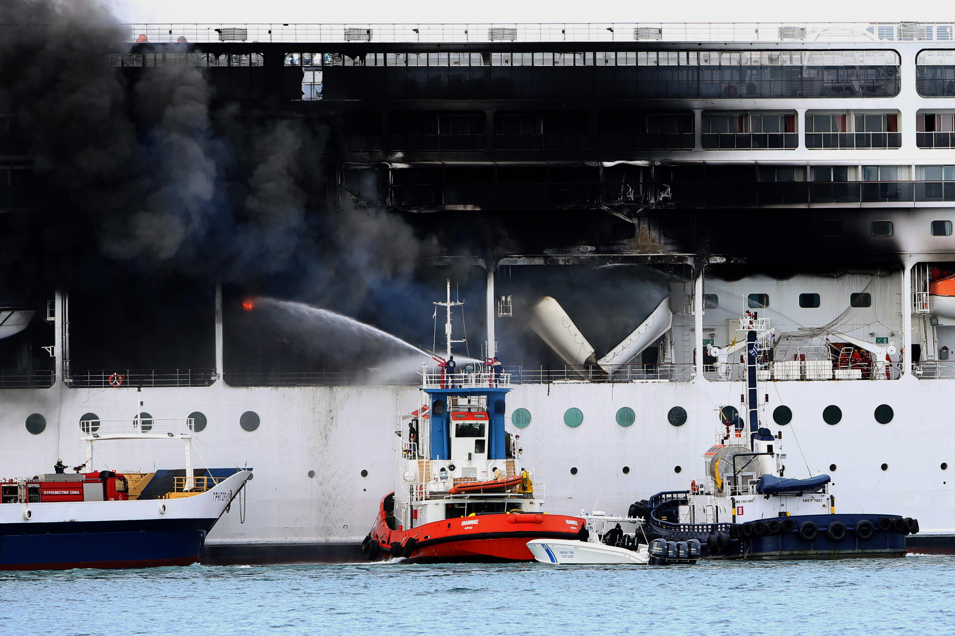 epa09069962 A fire broke out  on the 'MSC Lirica' cruiseship on 12 March 2021, while it was tied at the Corfu port, Ionian Sea, Greece, since January 30 for the winter season. Onboard were crew members only. The cause of the fire, which broke out at starboard, was not made known as of this writing. Firefighters were trying to put out the blaze.  EPA/STAMATIS KATAPODIS