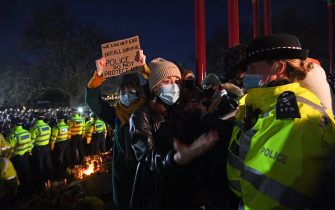A woman holds up a placard at the band stand in Clapham Common, London, after the Reclaim These Streets vigil for Sarah Everard was officially cancelled. Serving police constable Wayne Couzens, 48, has appeared in court charged with kidnapping and killing the marketing executive, who went missing while walking home from a friend's flat in south London on March 3. Picture date: Saturday March 13, 2021. (Photo by Victoria Jones/PA Images via Getty Images)