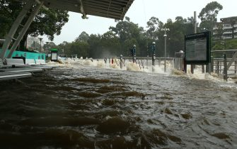 SYDNEY, AUSTRALIA - MARCH 20: Parramatta ferry wharf overflows and floods due to continuous and heavy rain on March 20, 2021 in Sydney, Australia. Heavy rain and flooding has trigger evacuations on the New South Wales mid coast with over 120mm rain expected for Sydney and residents urged to stay at home. (Photo by Matt Blyth/Getty Images)