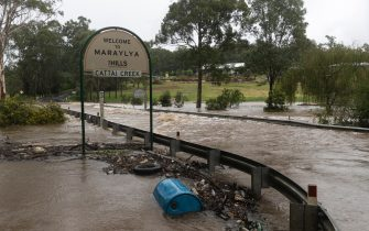MARAYLYA, AUSTRALIA - MARCH 20: Heavy floodwaters cover a roadway at Cattai Creek on March 20, 2021 in Maraylya, Australia. Heavy rain and flooding has trigger evacuations on the New South Wales mid coast with over 120mm rain expected for Sydney and residents urged to stay at home. (Photo by Brook Mitchell/Getty Images)