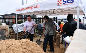 epa09084881 SES volunteers at Penrith SES making and providing free sandbags to residents, Sydney, Australia, 20 March 2021. More rain is forecast for the New South Wales coast and other parts of the state, with flood warnings in place and the premier advising residents to stay home.  EPA/DEAN LEWINS AUSTRALIA AND NEW ZEALAND OUT