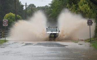 epa09084874 Road closure at Yarramundi Lane in Richmond, Australia, 20 March 2021. More rain is forecast for the New South Wales coast and other parts of the state, with flood warnings in place and the premier advising residents to stay home.  EPA/SIMON BULLARD AUSTRALIA AND NEW ZEALAND OUT