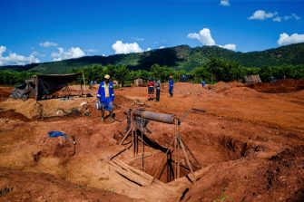 Miners walk near a mine shaft at Manzou Farm, owned by Grace Mugabe, wife of former Zimbabwean President Robert Mugabe, in Mazowe, Zimbabwe on April 5, 2018. - Local media reported on March 30, 2018 that illegal gold miners in Zimbabwe have seized a farm belonging to former first lady Grace Mugabe, just four months after former President Robert Mugabe was ousted from power. (Photo by Jekesai NJIKIZANA / AFP) (Photo by JEKESAI NJIKIZANA/AFP via Getty Images)