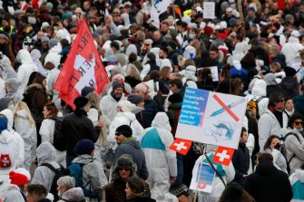 Protesters take part in a demonstration against the ongoing coronavirus Covid-19 restrictions in Liestal, near Basel, on March 20, 2021. - Between 3,000 and 5,000 people, some of them wearing white suits, take part in a 'silent demonstration on March 20, 2021 in Liestal, Northern Switzerland, demanding an end to restrictions designed to contain the Covid-19 pandemic. (Photo by STEFAN WERMUTH / AFP) (Photo by STEFAN WERMUTH/AFP via Getty Images)