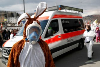 A protester wears a bunny costume and a diving mask during a demonstration against the ongoing coronavirus Covid-19 restrictions in Liestal, near Basel, on March 20, 2021. - Between 3,000 and 5,000 people, some of them wearing white suits, take part in a 'silent demonstration on March 20, 2021 in Liestal, Northern Switzerland, demanding an end to restrictions designed to contain the Covid-19 pandemic. (Photo by STEFAN WERMUTH / AFP) (Photo by STEFAN WERMUTH/AFP via Getty Images)