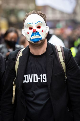 LONDON, UNITED KINGDOM - 2021/03/20: A protester wearing a mask takes part during the demonstration. Thousands of protesters take part in an anti-lockdown march. A World-Wide Rally for Freedom was organised a year after lockdowns were introduced to try and stop the spread of COVID-19. (Photo by Andy Barton/SOPA Images/LightRocket via Getty Images)