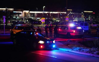 epa09090798 Police and officials investigate the scene of a mass shooting at the King Soopers supermarket in Boulder, Colorado, USA, 22 March 2021. At least ten people, including Boulder Police officer Eric Talley, were killed after a gunman, later taken into custody, started shooting in the parking lot and inside the supermarket.  EPA/BRENDAN DAVIS
