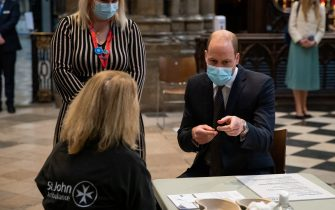 The Duke of Cambridge speaks to a member of staff with Pippa Nightingale (back left), chief nurse at Chelsea and Westminster Hospital NHS Foundation Trust, during a visit to the vaccination centre at Westminster Abbey, London, to pay tribute to the efforts of those involved in the Covid-19 vaccine rollout. Picture date: Tuesday March 23, 2021.