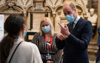 The Duke of Cambridge speaks to a member of staff with Pippa Nightingale (centre), chief nurse at Chelsea and Westminster Hospital NHS Foundation Trust, during a visit to the vaccination centre at Westminster Abbey, London, to pay tribute to the efforts of those involved in the Covid-19 vaccine rollout. Picture date: Tuesday March 23, 2021.