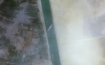 epa09096521 A handout satellite image made available by European Space Agency Copernicus Sentinel-2 Satellite Image via Maxar Technologies shows the container ship 'Ever Given' run aground in the Suez Canal, Egypt, 24 March 2021 (issued 25 March 2021). The large container ship Ever Given ran aground in the Suez Canal on 23 March, blocking passage of other ships and causing a traffic jam for cargo vessels. The head of the Suez Canal Authority announced on 25 March that 'the navigation through the Suez Canal is temporarily suspended' until the floatation of the Ever Given is completed. Its floatation is being carried out by eight large tugboats that are towing and pushing the grounding vessel.  EPA/European Space Agency Copernicus Sentinel-2 Satellite Image /via -- MANDATORY CREDIT: SATELLITE IMAGE 2020 MAXAR TECHNOLOGIES -- the watermark may not be removed/cropped -- HANDOUT EDITORIAL USE ONLY/NO SALES