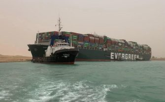 A handout photo made available by Media for the Suez Canal Head Office shows Egypt's Suez Canal blocked by a large container ship in Cairo, Egypt, 24 March 2021. A large container ship registered in Panama ran aground in the Suez Canal on 23 March, blocking passage of other ships and causing a traffic jam for cargo vessels. ANSA/Media Suez Canal Head Office / H  HANDOUT EDITORIAL USE ONLY/NO SALES