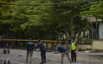 Indonesian forensic police examine the site after a suspected bomb exploded near a church in Makassar on March 28, 2021. (Photo by INDRA ABRIYANTO / AFP) (Photo by INDRA ABRIYANTO/AFP via Getty Images)
