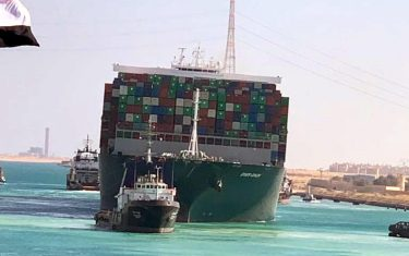 epa09105071 A handout photograph made available by the Syez Canal Authority shows the Ever Given container ship after it was refloated in the Suez Canal, Egypt, 29 March 2021. The head of the Suez Canal Authority announced on 29 March that the large container ship, which ran aground in the Suez Canal on 23 March, is now free floating after responding to the pulling maneuvers.  EPA/SUEZ CANAL AUTHORITY / HANDOUT  HANDOUT EDITORIAL USE ONLY/NO SALES
