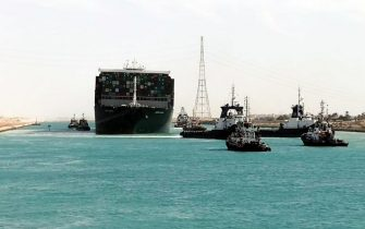 epa09105080 A handout photograph made available by the Syez Canal Authority shows the Ever Given container ship after it was refloated in the Suez Canal, Egypt, 29 March 2021. The head of the Suez Canal Authority announced on 29 March that the large container ship, which ran aground in the Suez Canal on 23 March, is now free floating after responding to the pulling maneuvers.  EPA/SUEZ CANAL AUTHORITY / HANDOUT  HANDOUT EDITORIAL USE ONLY/NO SALES