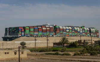"""29 March 2021, Egypt, Suez: The """"Ever Given"""" container ship operated by the Evergreen Marine Corporation, sails through the Suez Canal, after it was fully freed and floated. Egypt's Suez Canal Authority announced that the stranded massive container ship that has blocked the Suez Canal for nearly a week, has been fully dislodged and successfully floating in the canal. Photo: Mohamed Shokry/dpa (Photo by Mohamed Shokry/picture alliance via Getty Images)"""