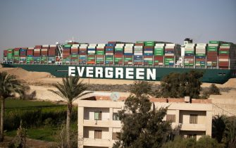 SUEZ, EGYPT - MARCH 29: The container ship, the Ever Given,is seen moving at the Suez Canal on March 29, 2021 in Suez, Egypt. Early Monday, the Suez Canal Authority said the angle of the Ever Given, a huge container ship stuck in the canal, had been corrected by 80 percent. The ship ran aground in the canal last Tuesday, after being caught in 40-knot winds. The Suez Canal is one of the worlds busiest shipping lanes and the blockage has created a backlog of vessels at either end, raising concerns over the impact the accident will have on global shipping and supply chains. (Photo by Mahmoud Khaled/Getty Images)