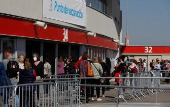 epa09092990 People queue up at Wanda Metropolitano stadium to be vaccinated against Covid-19 in Madrid, Spain, 24 March 2021. Spain resumes the use of the Astrazeneca coronavirus vaccine after a 10-day-long pause in its administration following the European Medicines Agency (EMA) announcement to uphold its approval of the vaccine. Some of EU member countries countries stopped giving the vaccine over fears there might be links between the vaccination against Covid-19 with the AstraZeneca vaccine and a rare number of blood clots.  EPA/J.J. GUILLEN