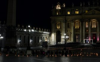 epa09112581 Pope Francis leads the Via Crucis, Way of the Cross, ceremony during Good Friday celebrations in a deserted Saint Peter's square, due to the Covid-19 pandemic, Vatican City, 02 April 2021.  EPA/ANGELO CARCONI / POOL