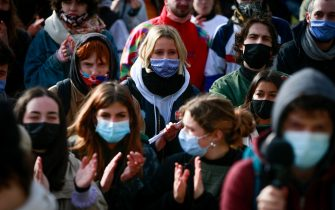 epa09076720 Students gather to protest against isolation and precariousness at the Universite Libre de Bruxelles in Brussels, Belgium, 15 March 2021. The students are asking, among other things, for the reopening of audiences, the resumption of extra-curricular activities, the resumption of sport, free psychological support, and a COVID-19 grant.  EPA/STEPHANIE LECOCQ