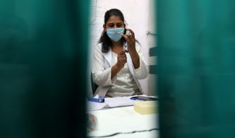 epa09110075 A health worker prepares a shot of Covaxin COVID-19 vaccine developed by Bharat Biotech at the vaccination center in New Delhi, India, 01 April 2021. Phase three of the COVID-19 vaccination has started in India on 01 April for people aged 45 and above.  EPA/RAJAT GUPTA