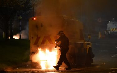 BELFAST, NORTHERN IRELAND - APRIL 03: Police attend the scene at Cloughfern as Loyalist protestors hijack and burn vehicles on April 3, 2021 in Belfast, Northern Ireland. Loyalist unrest and disorder in the province continues as a result of the implementation of the so called Irish sea border. (Photo by Charles McQuillan/Getty Images)