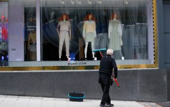 A worker cleans the windows at the Monki clothing store ahead of its reopening in Birmingham, U.K., on Monday, April 12, 2021. Non-essential retailers as well as pubs and restaurants with outdoor space will reopen Monday across England after almost 100 days of lockdown, hoping pent-up demand will translate into strong sales. Photographer: Darren Staples/Bloomberg via Getty Images