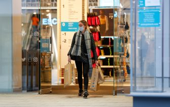 A customer leaves a Primark clothing store, with shopping bags, following its reopening in Birmingham, U.K., on Monday, April 12, 2021. Non-essential retailers as well as pubs and restaurants with outdoor space will reopen Monday across England after almost 100 days of lockdown, hoping pent-up demand will translate into strong sales. Photographer: Darren Staples/Bloomberg via Getty Images