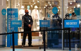 A security guard stands at the entrance to Primark clothing store following its reopening in Birmingham, U.K., on Monday, April 12, 2021. Non-essential retailers as well as pubs and restaurants with outdoor space will reopen Monday across England after almost 100 days of lockdown, hoping pent-up demand will translate into strong sales. Photographer: Darren Staples/Bloomberg via Getty Images