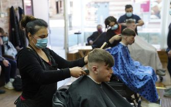 People get their hair cut at the Unique Traditional barber's in Whitley Bay, as England takes another step back towards normality with the further easing of lockdown restrictions. Picture date: Monday April 12, 2021. (Photo by Owen Humphreys/PA Images via Getty Images)