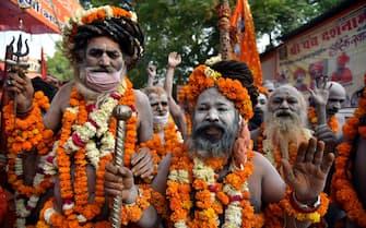 epa09130138 Indian holy men or Naga Sadhu during the Kumbh Mela royal bath (Sacred Hindu Pilgrimage) at Haridwar, Uttarakhand, India, 12 April 2021. Thousands of pilgrims are gathering and taking holy dip in Kumbh Mela that is a mass Hindu pilgrimage which occurs after every twelve years and rotates among four locations Prayag (Allahabad) at the confluence of the Ganga and Yamuna and mythical Saraswati river, Haridwar along the Ganga river, Ujjain along the Kshipra river and Nashik along the Godavari river.  EPA/IDREES MOHAMMED