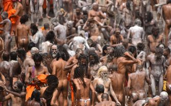epa09130360 Indian holy men or Naga Sadhu along with the other pilgrims take the holy dip in Ganga river during the Kumbh Mela royal bath m(Sacred Hindu Pilgrimage) at Haridwar, Uttarakhand, India, 12 April 2021. Thousands of pilgrims are gathering and taking holy dip in Kumbh Mela that is a mass Hindu pilgrimage which occurs after every twelve years and rotates among four locations Prayag (Allahabad) at the confluence of the Ganga and Yamuna and mythical Saraswati river, Haridwar along the Ganga river, Ujjain along the Kshipra river and Nashik along the Godavari river.  EPA/IDREES MOHAMMED