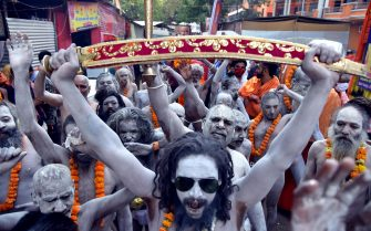 epa09130139 Indian holy men or Naga Sadhu with their bodies covered with holy ashes attend Kumbh Mela royal bath (Sacred Hindu Pilgrimage) at Haridwar, Uttarakhand, India, 12 April 2021. Thousands of pilgrims are gathering and taking holy dip in Kumbh Mela that is a mass Hindu pilgrimage which occurs after every twelve years and rotates among four locations Prayag (Allahabad) at the confluence of the Ganga and Yamuna and mythical Saraswati river, Haridwar along the Ganga river, Ujjain along the Kshipra river and Nashik along the Godavari river.  EPA/IDREES MOHAMMED