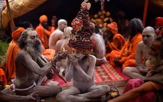 epa09130136 Indian holy men or Naga Sadhu during the Kumbh Mela royal bath (Sacred Hindu Pilgrimage) at Haridwar, Uttarakhand, India, 12 April 2021. Thousands of pilgrims are gathering and taking holy dip in Kumbh Mela that is a mass Hindu pilgrimage which occurs after every twelve years and rotates among four locations Prayag (Allahabad) at the confluence of the Ganga and Yamuna and mythical Saraswati river, Haridwar along the Ganga river, Ujjain along the Kshipra river and Nashik along the Godavari river.  EPA/IDREES MOHAMMED