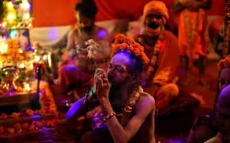 epa09130130 Indian holy men or Naga Sadhu during the Kumbh Mela royal bath (Sacred Hindu Pilgrimage) at Haridwar, Uttarakhand, India, 12 April 2021. Thousands of pilgrims are gathering and taking holy dip in Kumbh Mela that is a mass Hindu pilgrimage which occurs after every twelve years and rotates among four locations Prayag (Allahabad) at the confluence of the Ganga and Yamuna and mythical Saraswati river, Haridwar along the Ganga river, Ujjain along the Kshipra river and Nashik along the Godavari river.  EPA/IDREES MOHAMMED